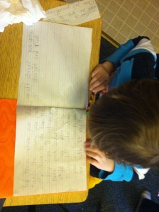 """1st Grader writing a """"How to Ski"""" manual."""