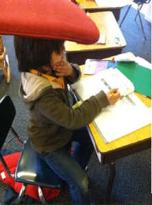 """3rd grader grabbed a pillow as a """"thinking cap"""" for an extra challenging math problem."""